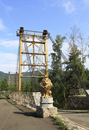 Golden lion sculpture and Suspension Bridge on the Katun River.