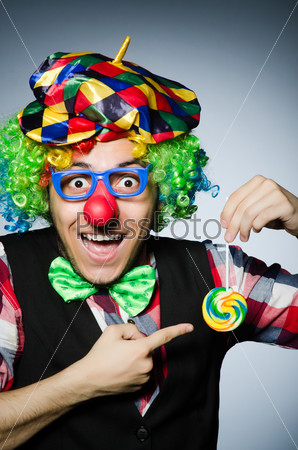 Funny clown with sweet lollipop