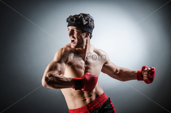 Muscular boxer wiith red gloves