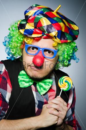 Funny clown with sweet lollipop
