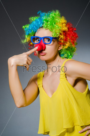 Funny woman in clown dressing