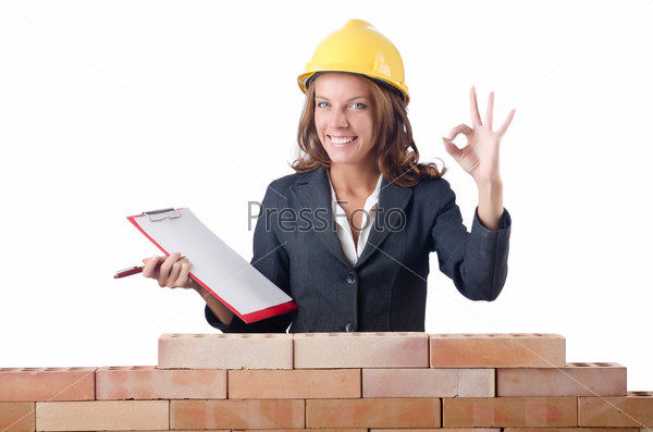 Woman with notepad on brick wall