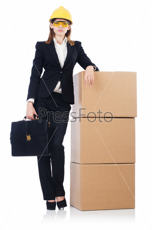 Young builder woman  with boxes  and bags  isolated on white