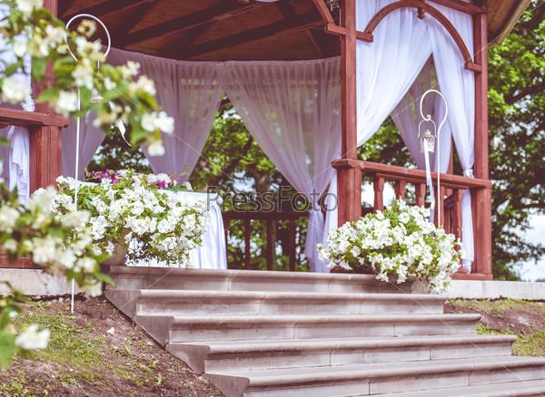 Beautiful wedding gazebo with flower decoration