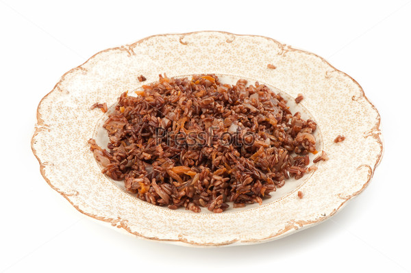 Red rice with onion and carrot