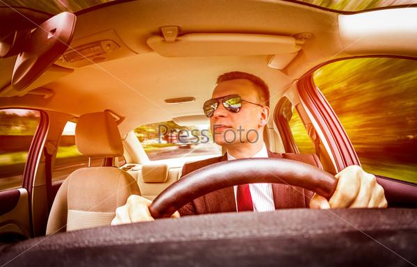 Man driving a car.