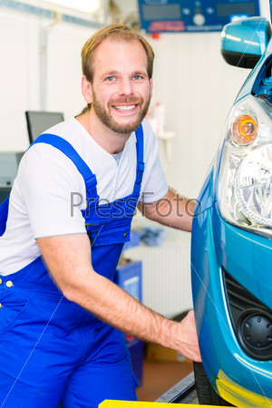 Car mechanic and auto in service workshop
