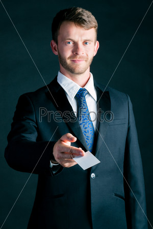 Businessman hand over business card