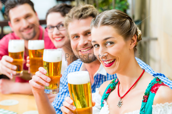 friends drinking beer in Bavarian restaurant or pub