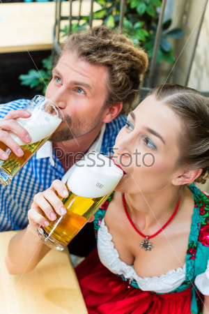 Young couple in Bavaria in restaurant or pub