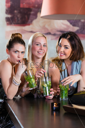 women or colleagues in cafe, bar or restaurant