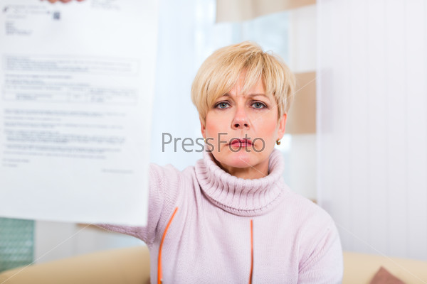 Senior at home receiving negative letter