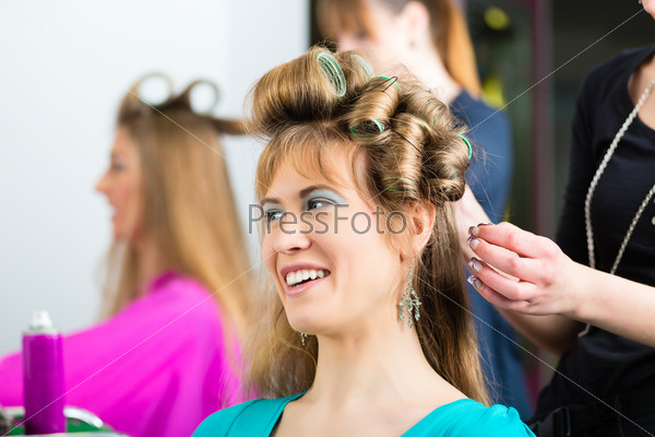 Women at the hairdresser with curls