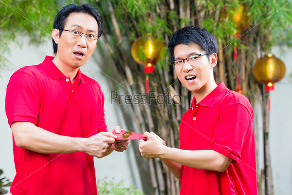 Father and son with Chinese new year gift
