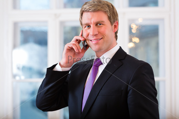 Laywer or Businessperson in Office on the phone