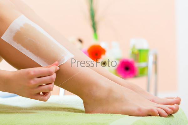 Woman in Spa getting leg waxed