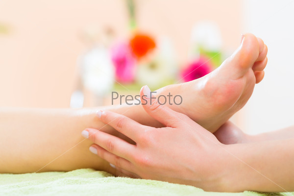 Woman in nail salon receiving foot massage