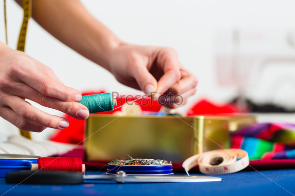 Fashion designer or tailor working in studio