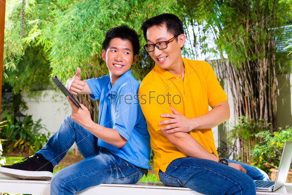 Chinese father and Asian Son at home
