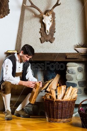 Young man in a hunter's cabin or alpine hut