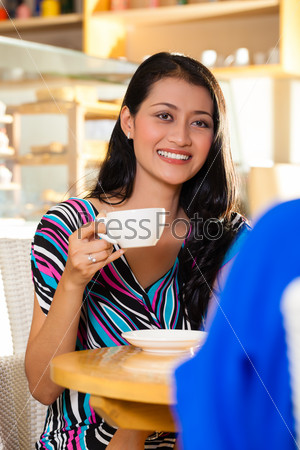 Young women in an Asian coffee shop
