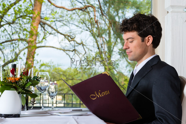 Businessman have a lunch in restaurant