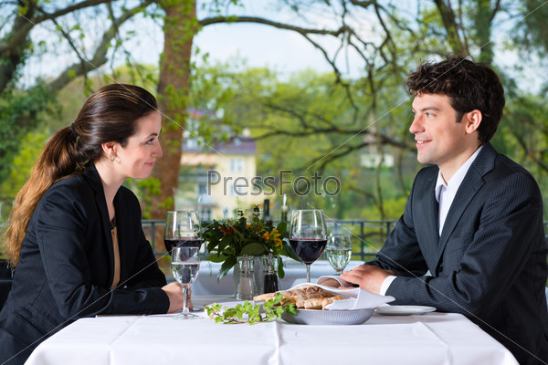 Businesspeople having lunch in restaurant