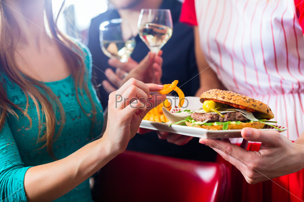 People in American diner or restaurant with wine