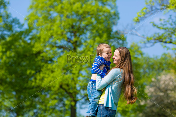 Mother and son on a summer meadow