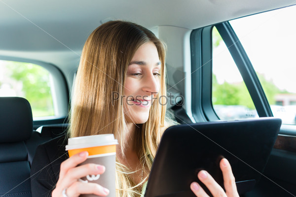 Woman traveling in taxi, she has an appointment