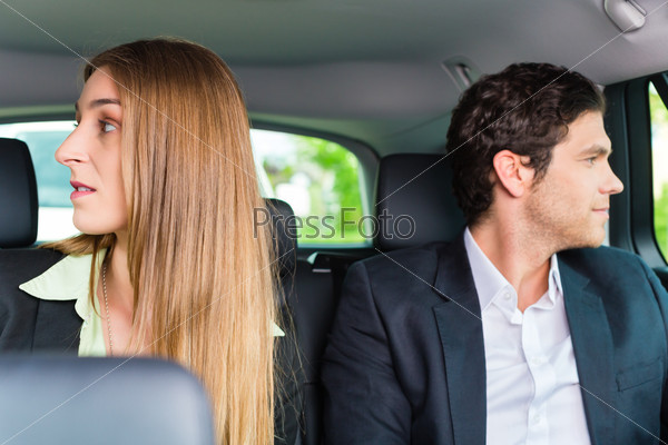 People traveling in taxi, they have an appointment