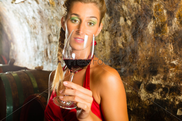 Woman with glass of wine looking skeptically