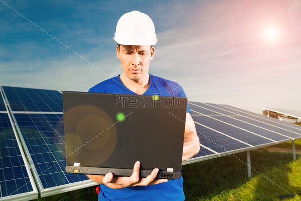 Green Energy - Solar panels with blue sky