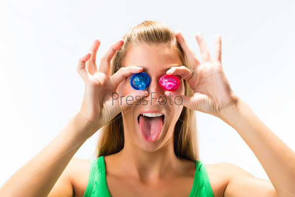 Young woman with a condom