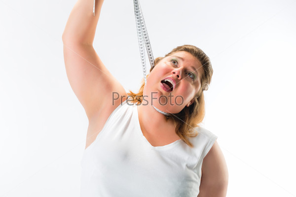 obese woman strangling herself with measuring tape