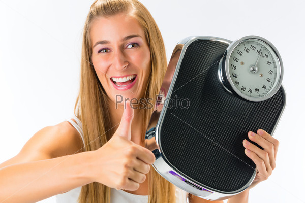Young woman with weight scale
