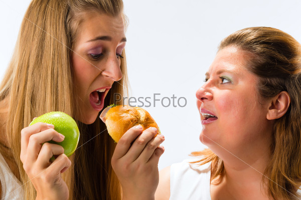 Thin and fat woman eating