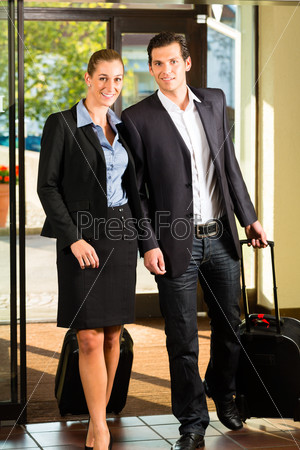 Business people arriving at Hotel