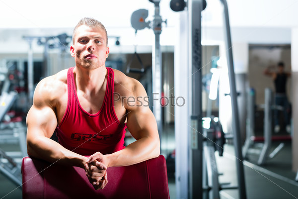 Bodybuilder or Trainer in a gym or fitness center