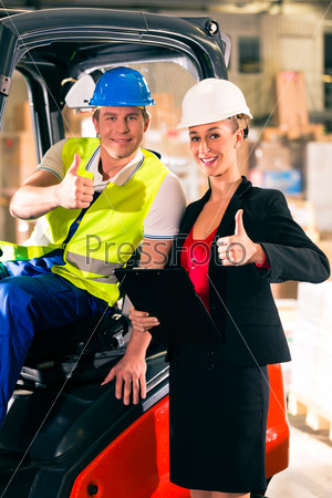 Forklift driver and supervisor at warehouse