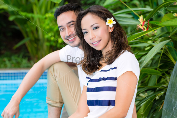 Asian couple outdoor in the garden