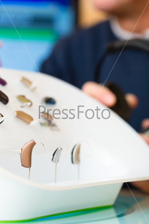Hearing aid on a presentation table