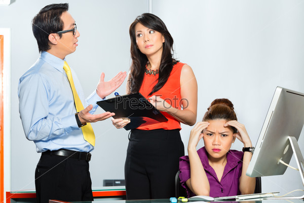 Asian colleagues mobbing or bullying employee