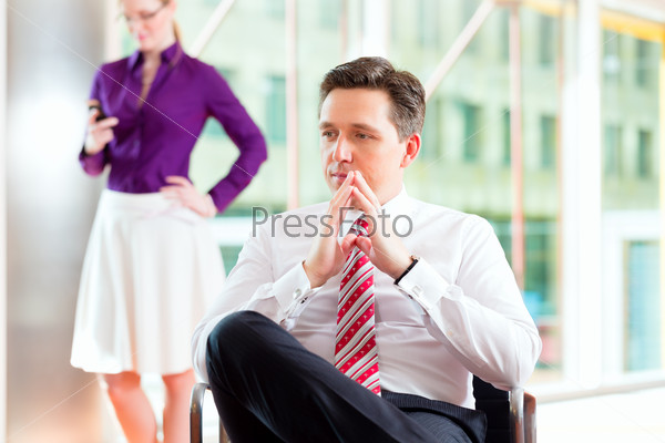 Business people - boss and secretary in office