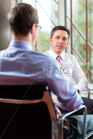 Business - young man and CEO in job interview