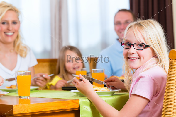 Family eating lunch or dinner