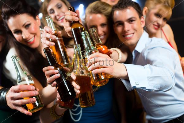People in club or bar drinking beer