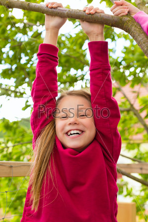 Happy child playing in the garden