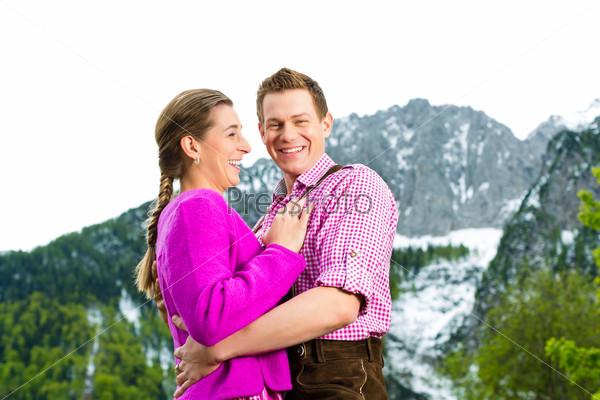 Happy couple in Alpine meadow