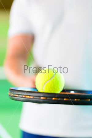Woman playing tennis in fitness club